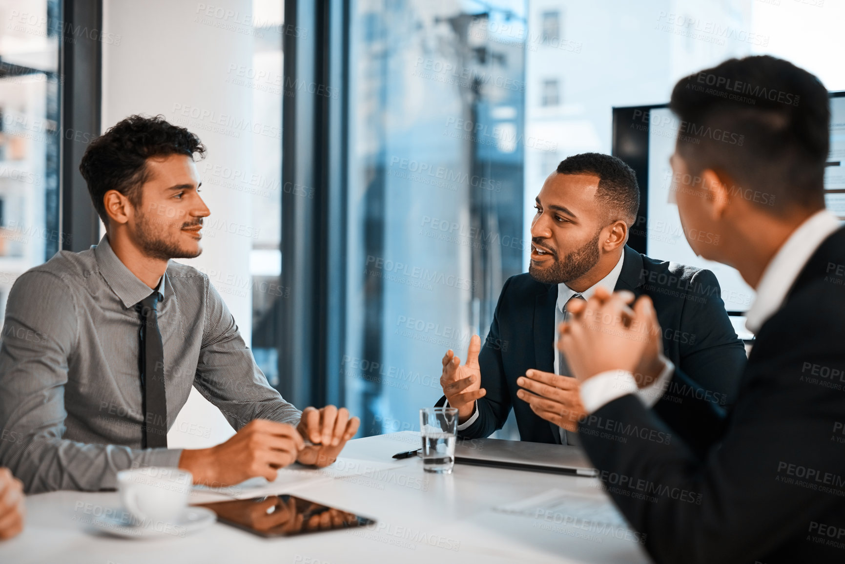 Buy stock photo Shot of a group of businessmen having a meeting in an office