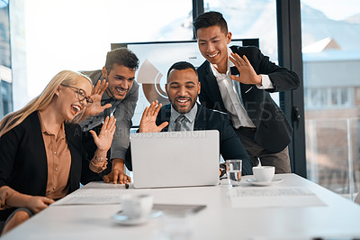 Buy stock photo Shot of a group of businesspeople making a video call on a laptop in an office