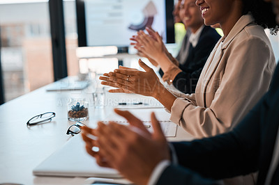 Buy stock photo Closeup shot of a group of unrecognizable businesspeople applauding during a meeting in an office