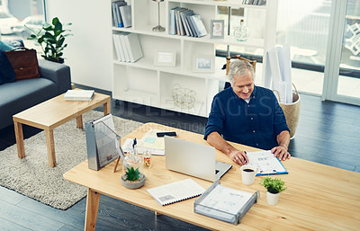 Buy stock photo High angle shot of a senior businessman working from home