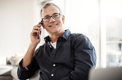 Buy stock photo Portrait of a mature man talking on a cellphone at home