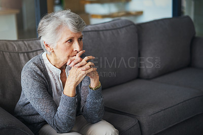 Buy stock photo Shot of a senior woman suffering from stress at home
