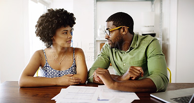 Buy stock photo Cropped shot of a young married couple planning their home budget together at home