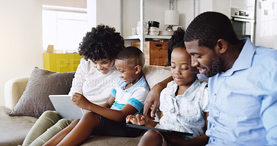 Buy stock photo Cropped shot of a young family spending time together in the living room at home