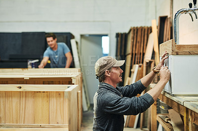 Buy stock photo Shot of carpenters working in a workshop
