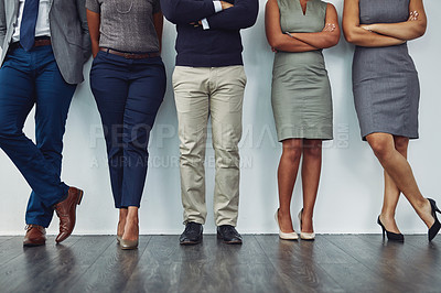 Buy stock photo Cropped shot of an unrecognizable group of businesspeople standing in line for their interview