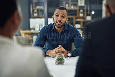 Buy stock photo Cropped shot of a handsome young businessman sitting in the boardroom during his job interview