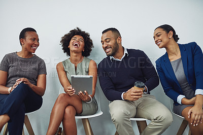 Buy stock photo Cropped shot of a group of businesspeople waiting in line for their interview