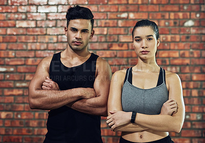 Buy stock photo Portrait of a confident young man and woman in a gym