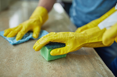 Buy stock photo Closeup shot of an unrecognizable couple cleaning a surface at home