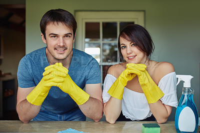 Buy stock photo Portrait of a young couple doing chores together at home