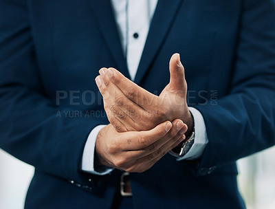 Buy stock photo Cropped shot of an unrecognizable businessman standing in an office