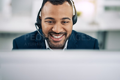 Buy stock photo Shot of a friendly businessman wearing a headset in an office