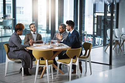 Buy stock photo Full length shot of a group of businesspeople sitting in the boardroom during a meeting