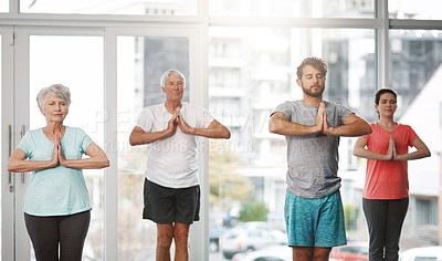 Buy stock photo Cropped shot of a group of people meditating while practicing yoga