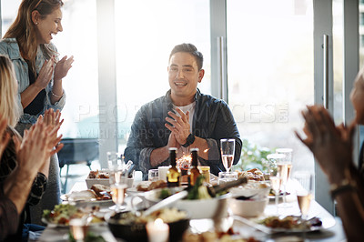 Buy stock photo Shot of a young man celebrating his birthday with his friends