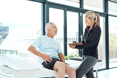 Buy stock photo Shot of a senior man consulting with his physiotherapist in her office