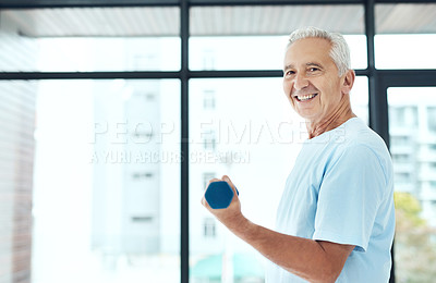 Buy stock photo Shot of a senior man working out with dumbbells