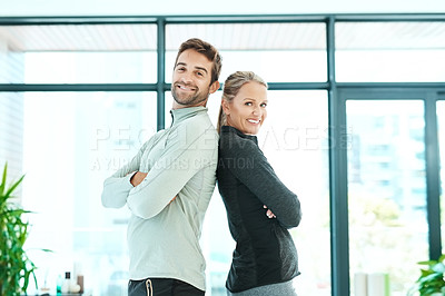 Buy stock photo Cropped shot of two people standing together in a fitness center