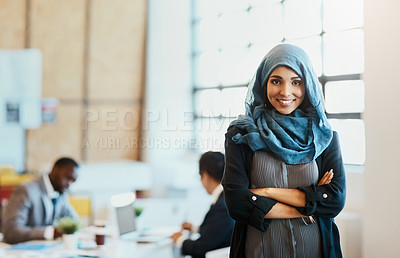 Buy stock photo Portrait of a confident young businesswoman standing in the office with her arms folded inside of the office at work