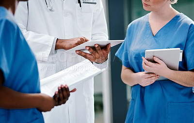 Buy stock photo Close shot of a group of medical practitioners having a discussion in a hospital