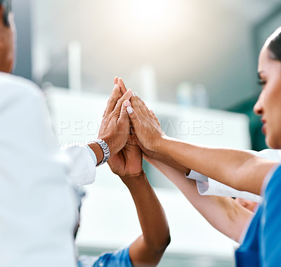Buy stock photo Shot of doctors in a hospitalCloseup shot of a group of medical practitioners high fiving in a hospital