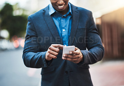 Buy stock photo Closeup shot of an unrecognizable businessman using a cellphone in the city