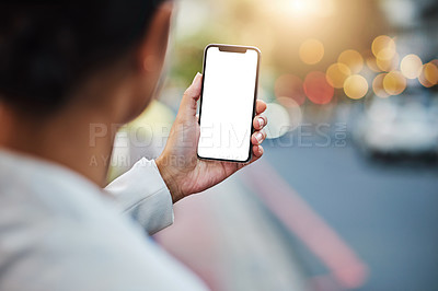 Buy stock photo Closeup shot of an unrecognizable businesswoman using a cellphone with a blank screen in the city