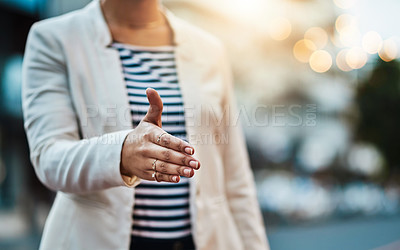 Buy stock photo Closeup shot of an unrecognizable businesswoman extending a handshake in the  city