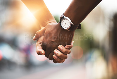 Buy stock photo Cropped shot of an affectionate couple holding hands outdoors