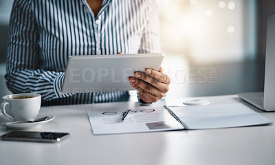 Buy stock photo Closeup shot of an unrecognizable businesswoman working on a digital tablet in an office