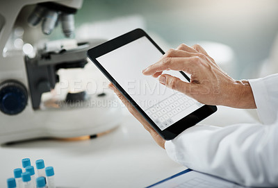 Buy stock photo Cropped shot of an unrecognizable mature female scientist using a tablet while doing research in her lab