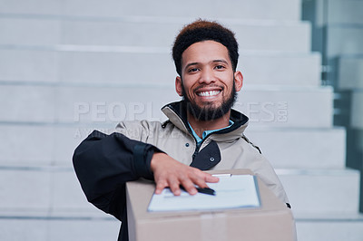 Buy stock photo Shot of a young delivery man making a home delivery