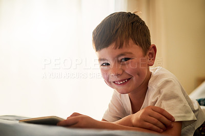 Buy stock photo Portrait of a little boy using a digital tablet at home