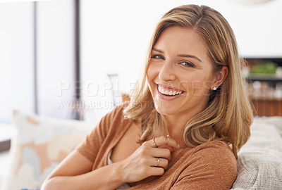 Buy stock photo Portrait of an attractive young woman relaxing on the sofa at home