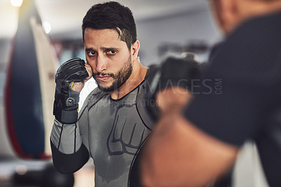 Buy stock photo Shot of a professional fighter training in the gym