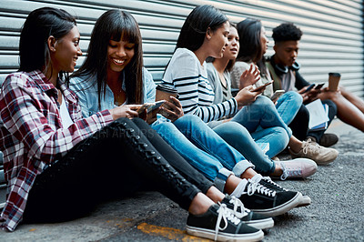 Buy stock photo Shot of a group of university students having a break outside at campus