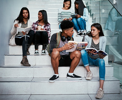 Buy stock photo Shot of a group of university students working together on the staircase at campus