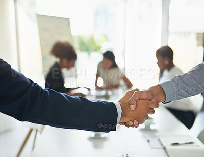 Buy stock photo Cropped shot of unrecognizable businesspeople shaking hands in a meeting