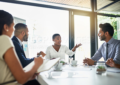 Buy stock photo Cropped shot of a group of businesspeople sitting in the boardroom