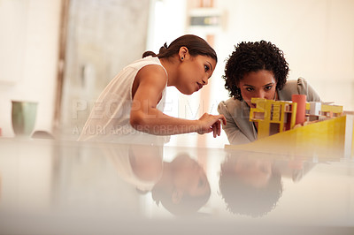 Buy stock photo Cropped shot of young businesswomen working together in the office