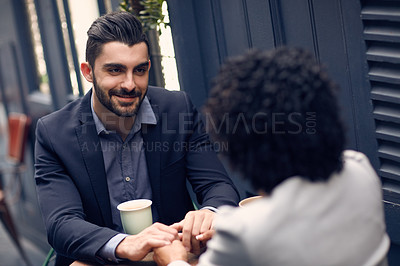 Buy stock photo Cropped shot of a young attractive couple having coffee at a cafe