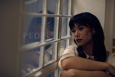 Buy stock photo Cropped shot of a young attractive woman feeling depressed at home