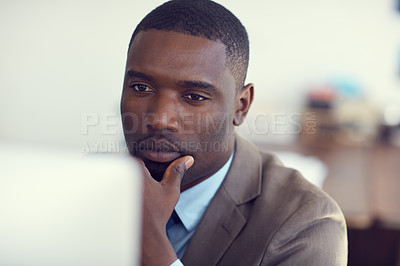 Buy stock photo Cropped shot of a young handsome businessman working in the office