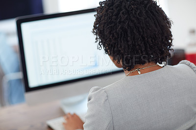 Buy stock photo Rearview shot of an unrecognizable businesswoman working in the office