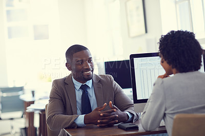 Buy stock photo Cropped shot of a young businessman and businesswoman talking in the office