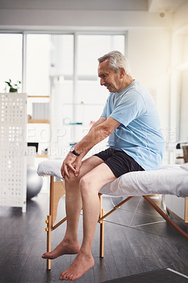 Buy stock photo Shot of a senior man in a rehabilitation centre