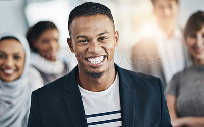 Buy stock photo Portrait of a cheerful young businessman standing in the office at work during the day