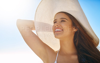 Buy stock photo Closeup shot of a beautiful young woman spending some time at the beach