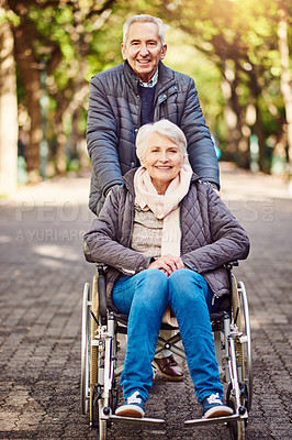 Buy stock photo Full length portrait of a wheelchair-bound senior woman spending the day with her husband in the park